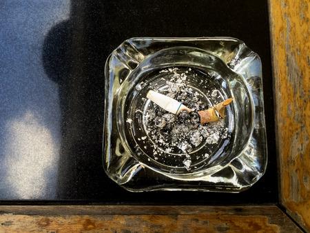 habbit: Ashtray on the Table Stock Photo
