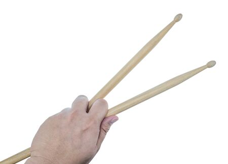 drum sticks: Isolated male left hand holding drum sticks on white background