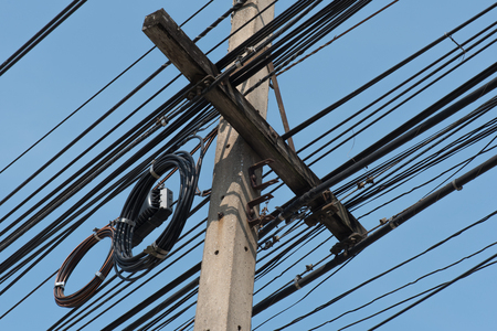 wire mess: Messy power lines on electric pole with clear sky Stock Photo