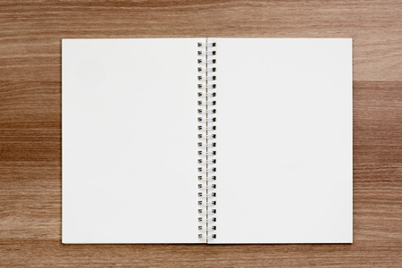 spiral binding: Opened blank ring spiral binding notebook on wooden surface, writing concept, your own contents, space for text Stock Photo