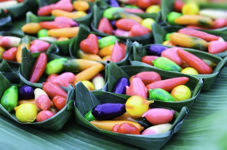Bake candy colors on banana leaf Stock Photo