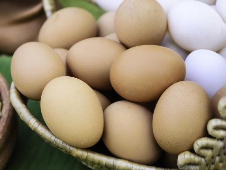 Eggs in one basket on banana leaf Stock Photo