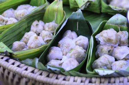 Malcolm dumplings steamed in banana leaves Stock Photo