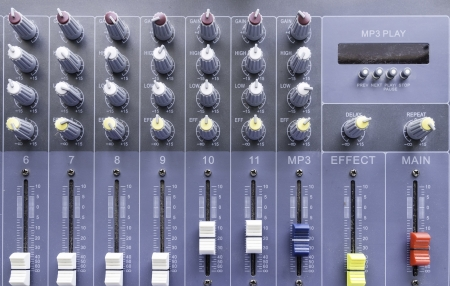 sliders of a mixing console. It is used for audio signals modifications Stock Photo
