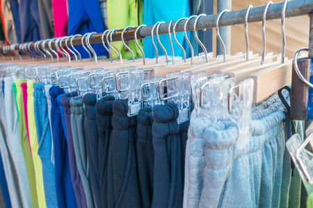 Clothes on hangers in a clothes shop