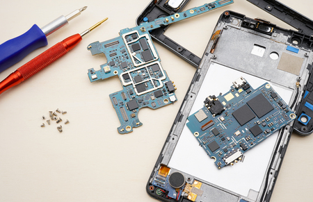 Disassembly smartphone and another part with  tool.Preparing for fix circuit board of cell phone.
