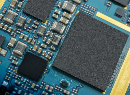 Close up micro chip on circuit board.