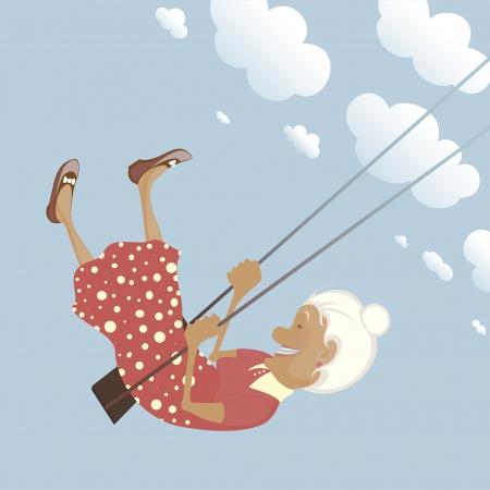 Una abuela graciosa en el columpio es feliz como un niño.