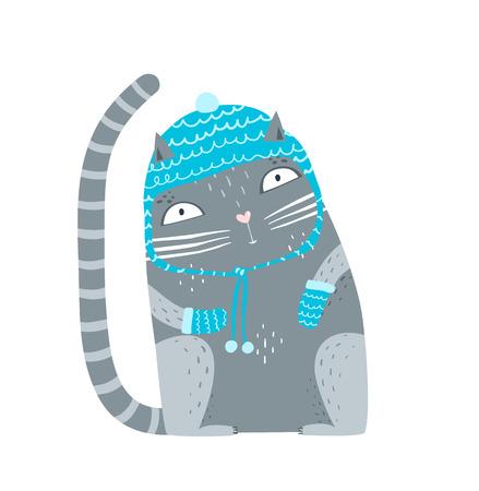 Cute pet kitten sitting in woollen winter clothes.