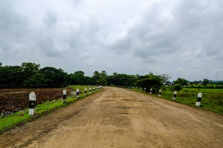 Non-asphalt road in upcountry Buriram, Thailand