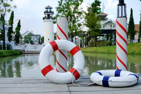 Rubber band on the pier with pond background