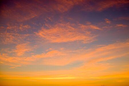 sunset sky shading background from orange to blue 免版税图像