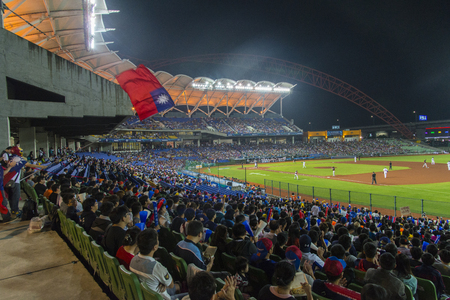 Taichung, Taiwan - October 12, 2015: Many fans watch the game atTaichung Intercontinental Baseball Stadium