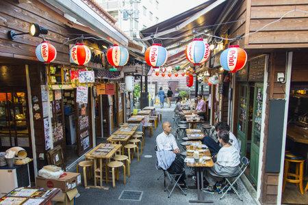 Okinawa streets ,Okinawa, Japan -April 19 ,2018:Many tourists eat at restaurants in the streets of Okinawa