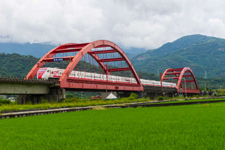 Yuli train bridge: Taichung,Taiwan -August 18 ,2018:Train driving on Yuli train bridge Train driving on Yuli train bridge 新闻类图片