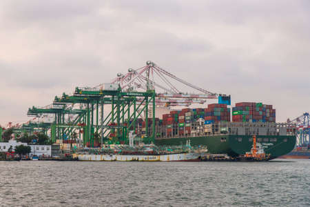 freighter:Kaohsiung, Taiwan -October 21 ,2018:Freighter unloading at the doc 新闻类图片