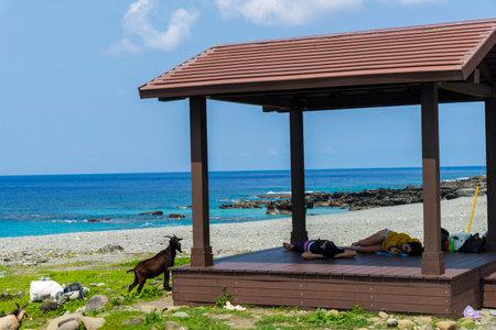 Lanyu beach:Lanyu, Taiwan -April 23 ,2019:Tourists take a leisurely rest at Lanyu Beach