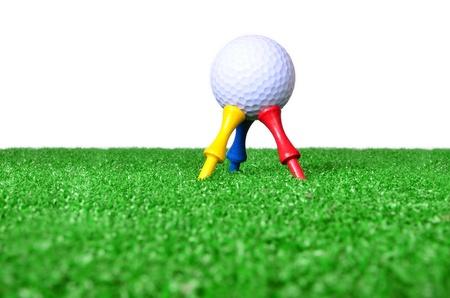 Yellow, blue, red golf tee photo