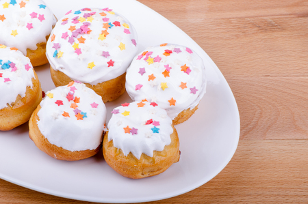 sprockets: Cake on a white plate with colored sprinkles in the form of stars