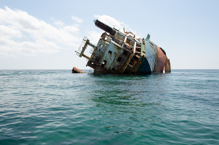 ship wreck: Shipwreck, rusty ship wreck, sunken ship on a bright sunny day