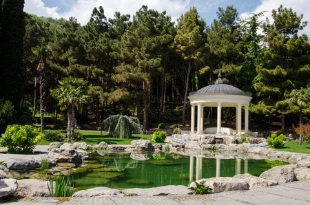 summerhouse: the gazebo in the antique style, with columns on the waterfront, Park Aivazovsky, Crimea, Russia