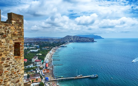 shore line: view from the fortress of the bay and the city with the mountains in the background, Sudak, Crimea