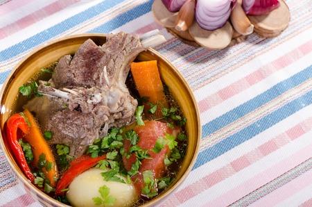 the lamb: soup shurpa - traditional oriental dish with lamb, carrots, onions, peppers, tomatoes and potatoes seasoned with spices and parsley