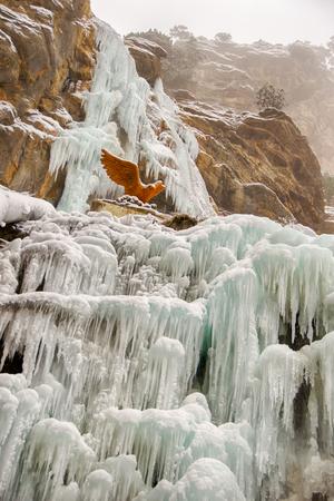 eagle canyon: Frozen waterfall Uchan-Su, mount AI-Petri on a cloudy snowy day