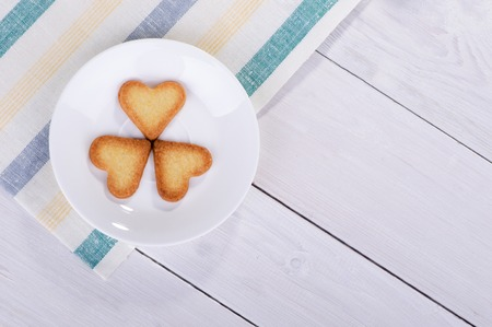 cooky: Cookies in the shape of a heart on a saucer, top view Stock Photo