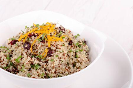 Quinoa salad with cranberries and orange zest. Close-up. Superfoods concept. Stock Photo