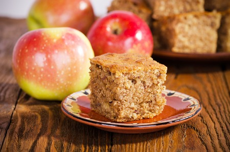 A piece of walnut cake with apples