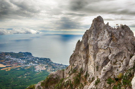 Beautiful landscape. View from the Ai-Petri mountain to the forest, the sea and the city of Yalta on a cloudy autumn day.