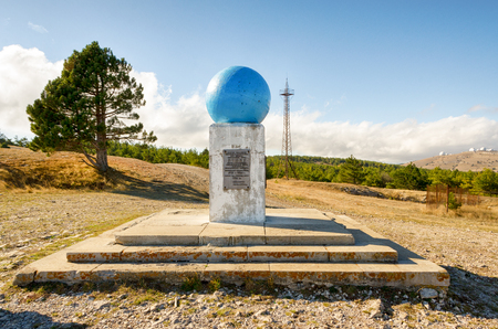 The monument Ai Petrine Meridian, established in 1913. Cast-iron globe on a stone pedestal. Reklamní fotografie