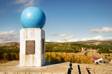 The monument Ai Petrine Meridian, established in 1913. Cast-iron globe on a stone pedestal. Stock Photo