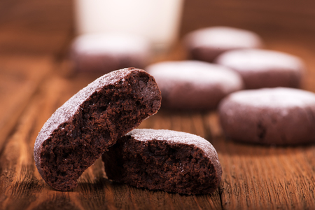 Chocolate cookies on a wooden background close up