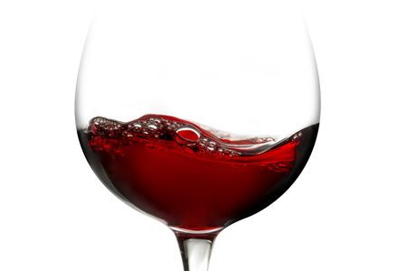 red wine in a glass isolated on white background