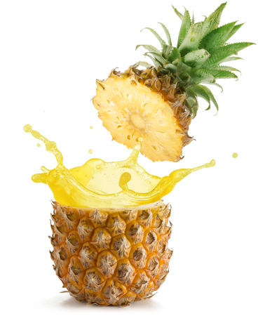 juice splashing out of a pineapple isolated on white background Standard-Bild
