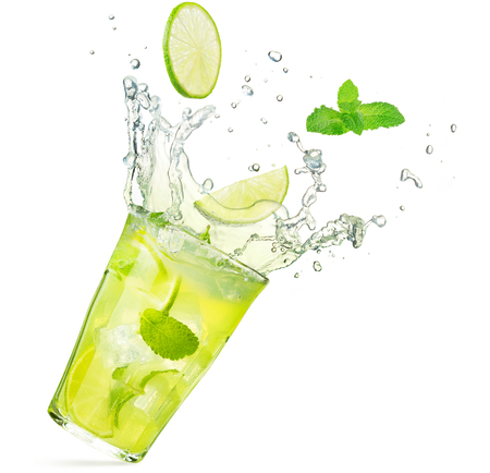 lime and mint falling into a splashing mojito cocktail isolated on white background Stock Photo