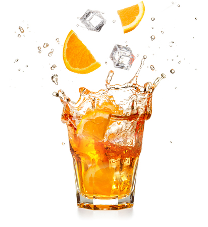 orange slices and ice cubes dropping into a splashing cocktail isolated on white background Stockfoto