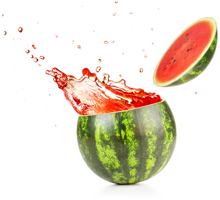 juice exploding out of a watermelon isolated on white background Stock Photo