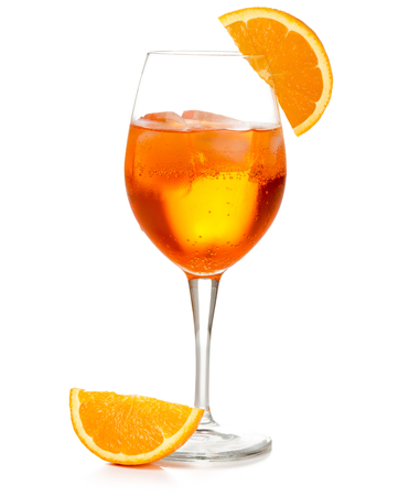 spritz cocktail in a wineglass garnished with orange slice isolated on white
