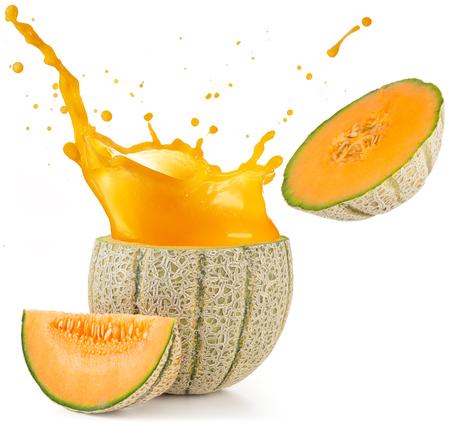 orange juice splashing out of a melon isolated on white Stockfoto
