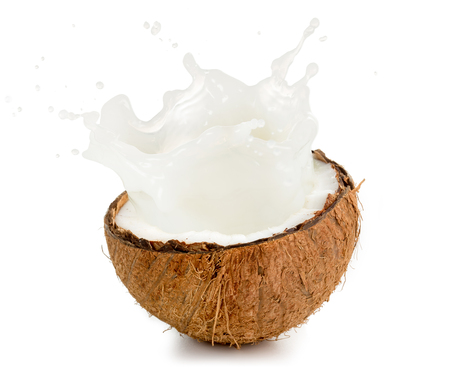 coconut milk spilling out of an half fruit Stock Photo