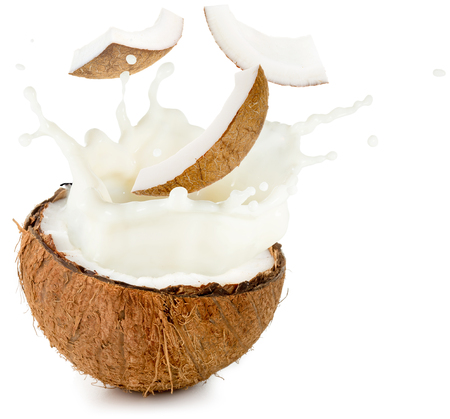 coconut milk and pieces spilling out half nut