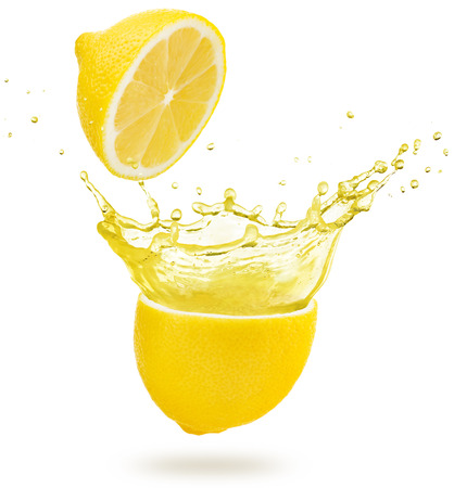 yellow juice exploding out of a lemon isolated on white background Stock Photo