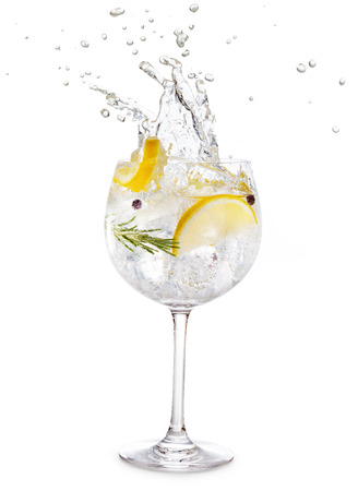 gin tonic splashing isolated on white background 스톡 콘텐츠