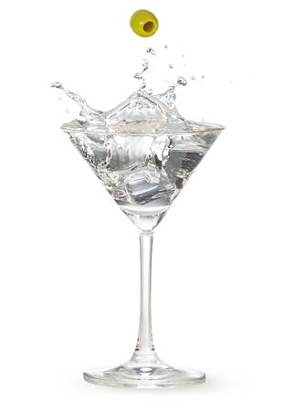 green olive falling into martini splashing isolated on white