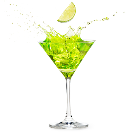 lime slice falling into splashing green cocktail isolated on white 스톡 콘텐츠