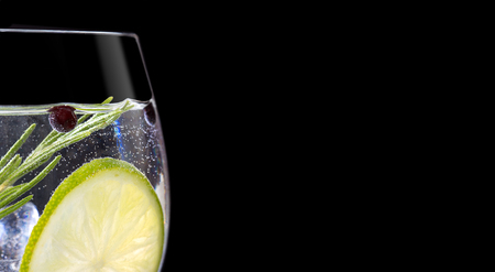 Close up of gin tonic glass on black background