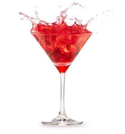 red cocktail splashing on white background Banco de Imagens